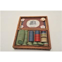 18AP-82 POKER CHIPSLot of dozens of misc. older poker chips,  some in carved wooden box; others in b
