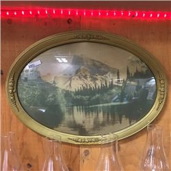 LOT77: Oval Framed Convex Glass Colored Photo Mountain Scene