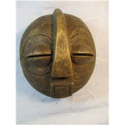 Vintage carved wooden mask from Africa