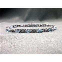 Diamond & Blue Topaz Infinity Bracelet