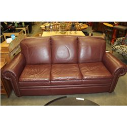BURGUNDY LEATHER SOFA WITH BRASS STUDDED ACCENT