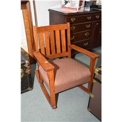 Antique mission style quarter cut oak rocking chair with upholstered seat