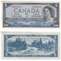 1954 Devil's Face $5.00 Note with Coyne-Towers Signatures in VF-EF Condition. The Note has a very mi