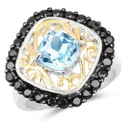 STERLING SILVER BLUE TOPAZ AND BLACK SPINEL RING