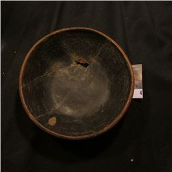 Killed Native American bowl with black interior and red exterior. I am not sure of the provenance or