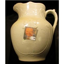 "Antique Stoneware off-white colored Pitcher, no wash bowl. Several hair line cracks. 10 1/2""."