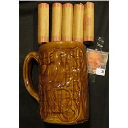 Morton Parrot design brown-glazed Stoneware Beer Mug with (5) Rolls of Bank-wrapped Wheat Cents.