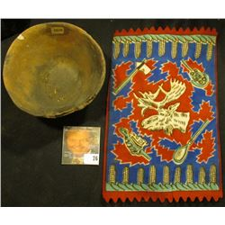 Old tobacco Flannel with Indian Motif and an excavated partially restored Indian Pot with museum num