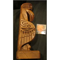 "9 1/2: hand carved Wooden Totem Pole, Carved on bottom ""By Kiana of Alaska""."