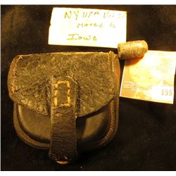 """Civil War Leather Bullet Pouch with a 58 caliber Conical Bullet. Tag states """"NY 117th Vol.30 Moved t"""