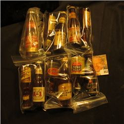 Collection of (11) Different miniature Whiskey, Beer, or Liquor Bottles.