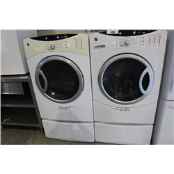 GE FRONT LOAD WASHER AND DRYER SET ON PEDESTALS