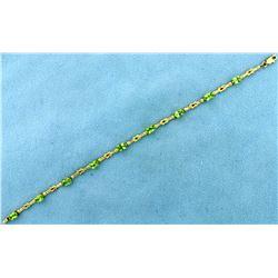 Unique Knot Link 4.5ct TW Peridot Gold Bracelet