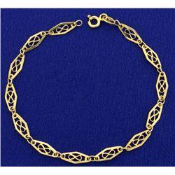 Italian Made Designer Infinity Link Bracelet in 18K Yellow Gold