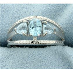 Three Stone Blue Topaz Ring with Diamonds