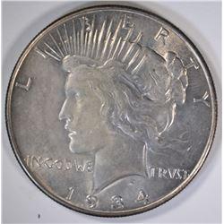 1934 PEACE SILVER DOLLAR, CHOICE BU