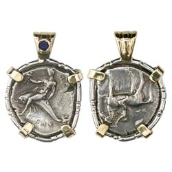 """Calabria, Tarentum, AR nomos, ca. 280 BC, """"boy on dolphin,"""" mounted in sterling silver bezel with 14"""