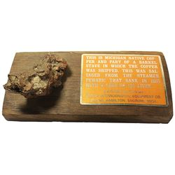 Copper ore specimen from the Pewabic (1865) mounted on wood from the wreck with informational plaque