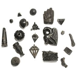 Lot of nineteen jet and ebony amulets and beads, Spanish colonial (1600s).