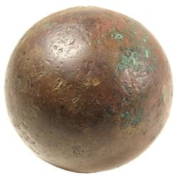 Small bronze cannonball with hollow core, 1600s, found in Haiti.