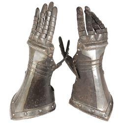 Pair of antique German armor gauntlets, 1600s.