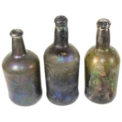 Lot of three black-glass ale bottles, ca. 1750-90.