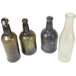 Lot of four bottles: Two black-glass ales and one cylinder, 1750-90, plus one clear milk bottle, ca.
