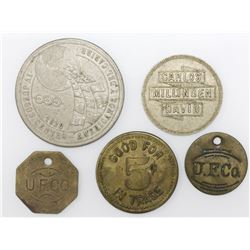 Lot of five brass or base metal tokens related to Panama, ca. early 1900s.