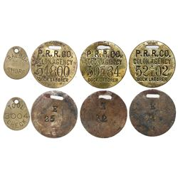 Lot of four Panama brass railroad work checks, early to mid-1900s.