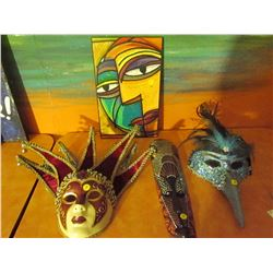 2 Masquerade masks and 2 mask wall hangings
