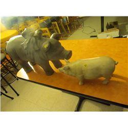 2 decorative pigs