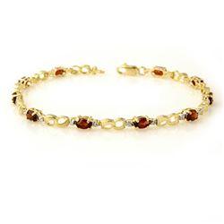 2.76 CTW Garnet & Diamond Bracelet 10K Yellow Gold - REF-26W2F - 12864