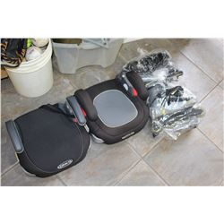 TWO BOOSTER SEATS AND TWO PAIR OF ROLLER BLADES