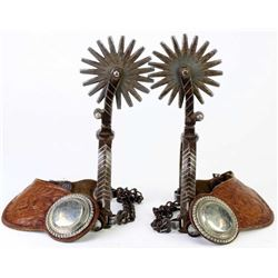 Large unmarked spurs with inlaid silver chevrons