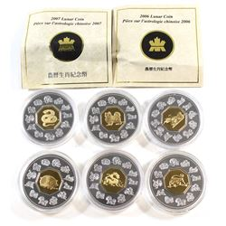 RCM Lot: 1999-2007 Canada $15 Gold Plated Sterling Silver Lunar Series Coins in Capsules. You will r