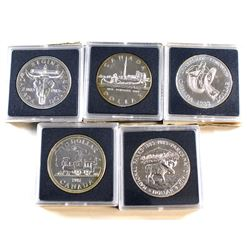 RCM Issue: 1981-1985 Canada Brilliant Uncirculated Silver Dollars (lightly toned). 5pcs
