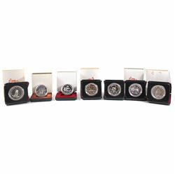 RCM Issue: 1974, 1975, 1976, 1977, 1978, 1979 & 1980 Canada Silver Dollars. Coins come encapsulated