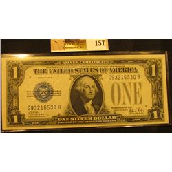 "Series 1928B One Dollar Silver Certificate ""Funny Back"", S/N G93216530B, signed by Woods/Mills, Frie"