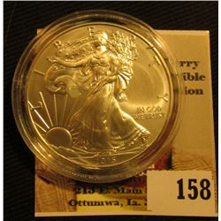 2015 $1 Silver Eagle in holder with Certicate of Authenticity from the American Mint. Brilliant Unci