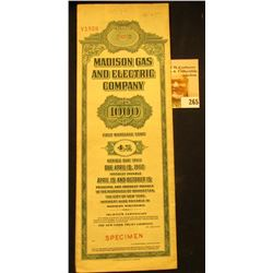 "Red stamped ""Specimen"" ""Madison Gas and Electric Company $1000 First Mortgage Bond 4% Series Due 196"
