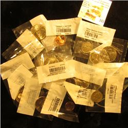 Nice selection of U.S. Coins sealed and graded in Littleton Coin Company Cellophane holders. Include
