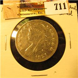 1821 Capped Bust Half Dollar, scratched and cleaned, otherwise VF-EF.