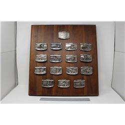 Wooden Display of Massey Harris Belt Buckles (16)