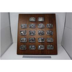 Wooden Display of Massey Harris Belt Buckles (18)