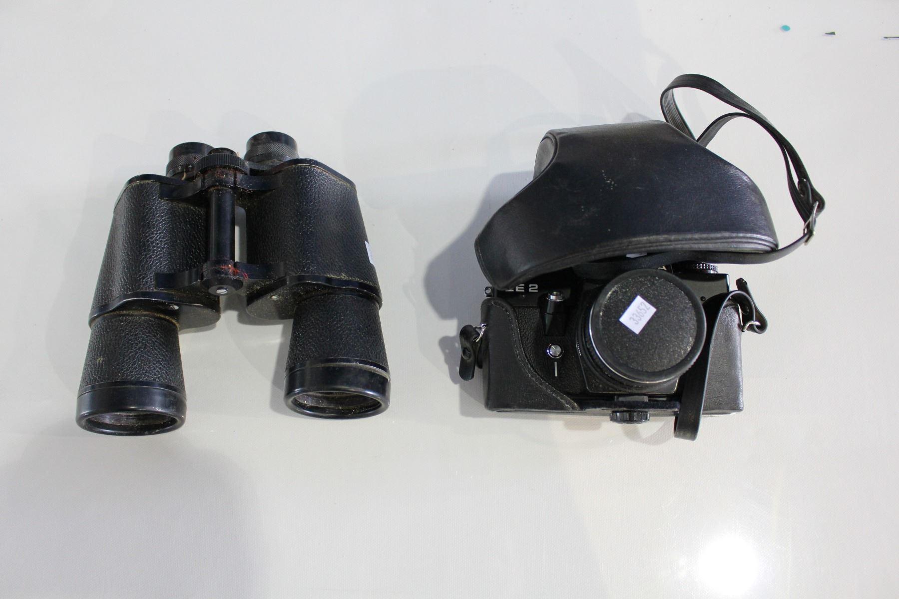 Shelf including praktica camera binoculars