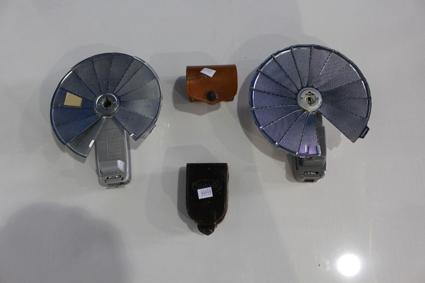 Shelf including praktica camera binoculars cufflinks and camera