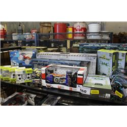 SHELF LOT OF RC VEHICLES INCLUDING HELICOPTERS, TRUCKS, CARS AND MORE
