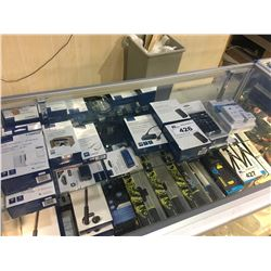 SHELF OF ASSORTED ADAPTERS, CHARGERS, ETC