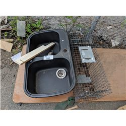 KITCHEN SINK AND LIVE ANIMAL TRAP