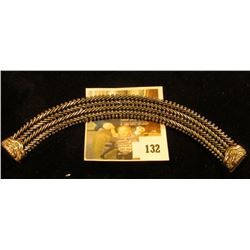 HEAVY, WIDE sterling bracelet with 14K accents and small diamonds at clasp. Marked 925 14K V, length